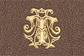 Экслибрис в виде переплетенных инициалов владельца на передней крышке, с золочением